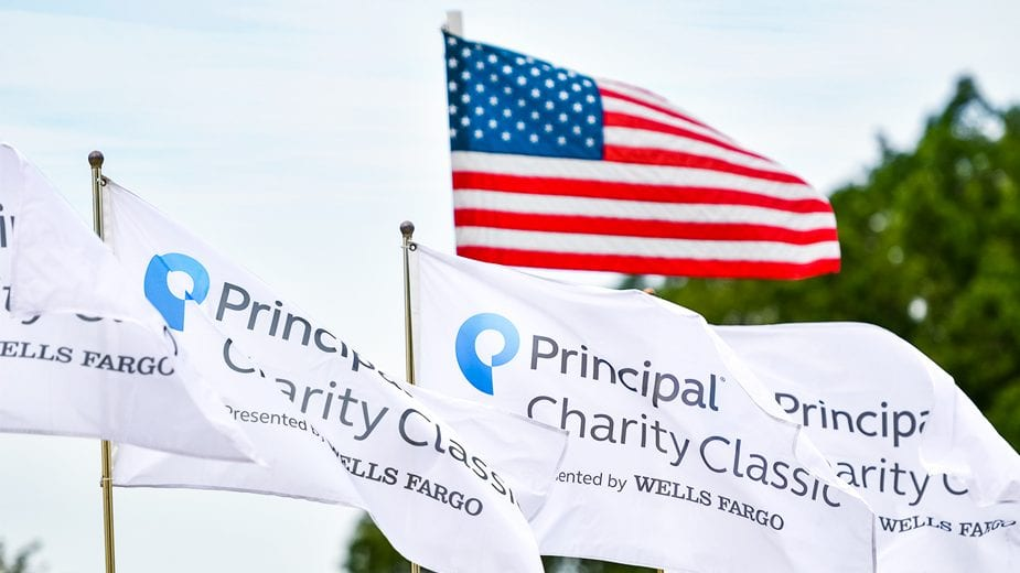 The American Flag flying higher than 4 white Principal charity classic flags